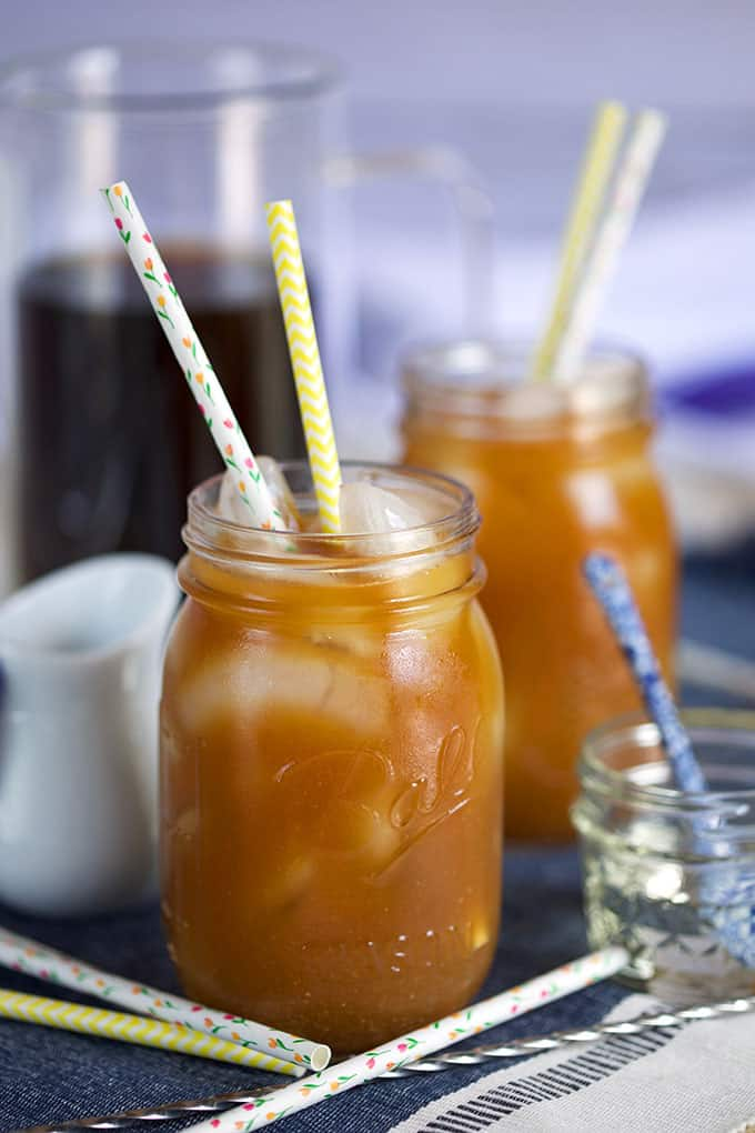 Cold Brew coffee in a mason jar with paper straws from Thesuburbansoapbox.com