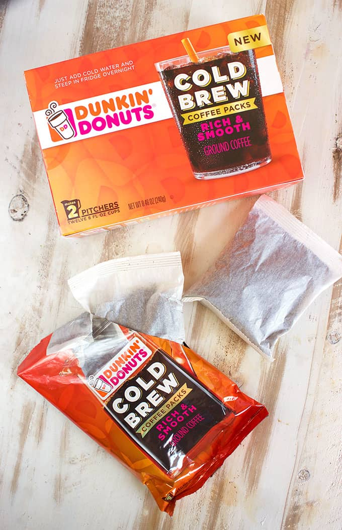 Dunkin Donuts Cold Brew packets on a white wood background from TheSuburbanSoapbox.com