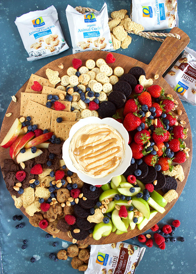 Overhead shot of fruit and cookie charcuterie tray with fluffernutter dip in a white bowl from TheSuburbanSoapbox.com