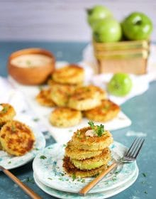 Fried Green Tomatoes on an aqua splattered plate with a wood fork on a blue background from TheSuburbanSoapbox.com