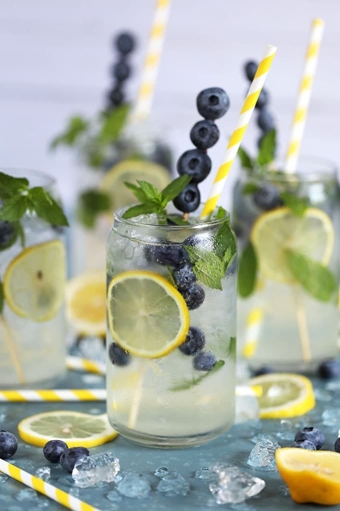 Lemonade Gin Mojito Cocktail on a blue background from TheSuburbanSoapbo