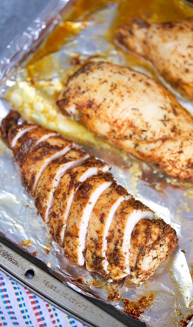 Overhead shot of sliced chicken breast on a foil lined baking sheet from TheSuburbanSoapbox.com