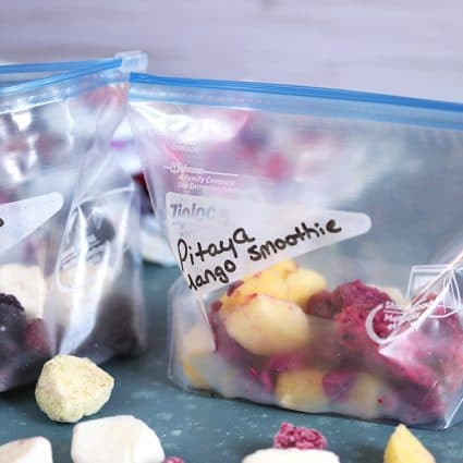 Frozen fruit and yogurt in zip top bags on a blue background from TheSuburbanSoapbox.com