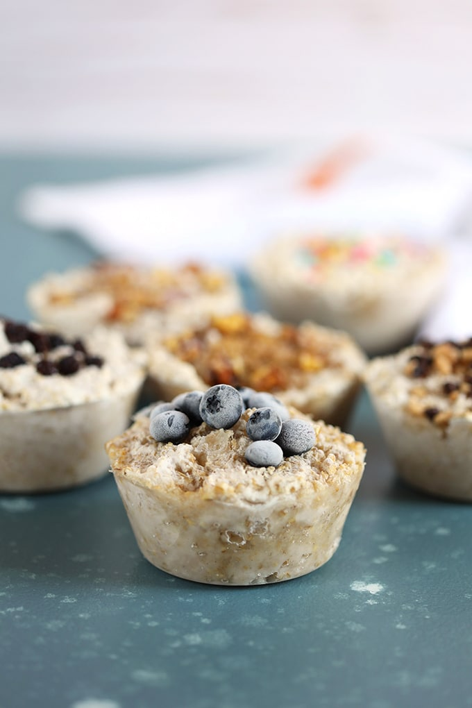 Steel Cut Oatmeal freezer muffins on a blue background from TheSuburbanSoapbox.com