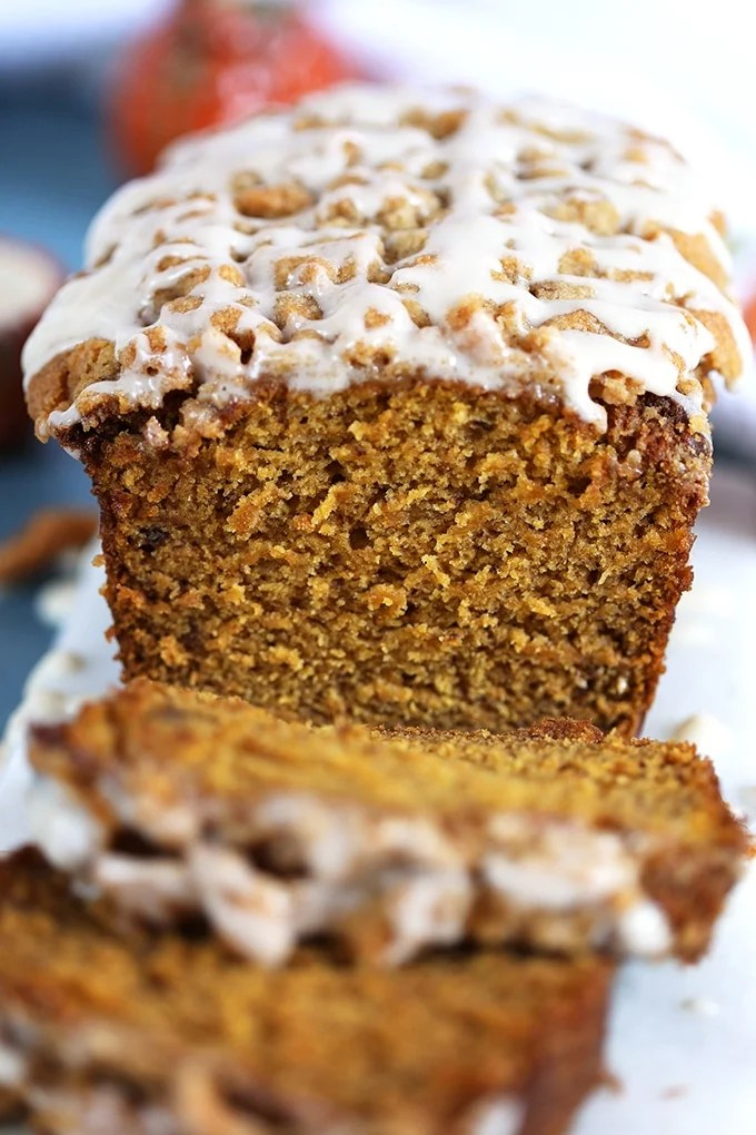 Close up of inside Maple Glazed Pumpkin Banana Bread with slices in front.