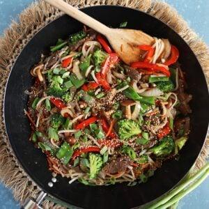 Overhead shot of beef stir fry recipe in a black wok.
