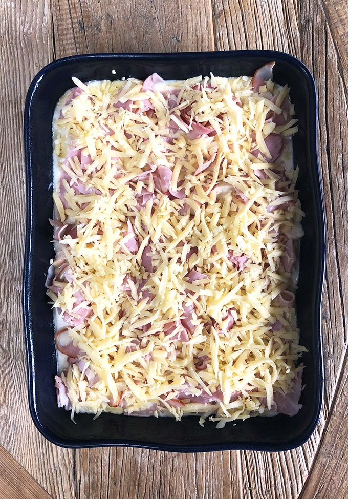Chicken Cordon Bleu Casserole process shot with cheese layer.