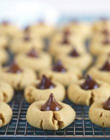 Peanut Butter Blossom cookies on a cooling rack.
