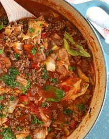 Overhead close up of Stuffed Cabbage Soup with wooden spoon.