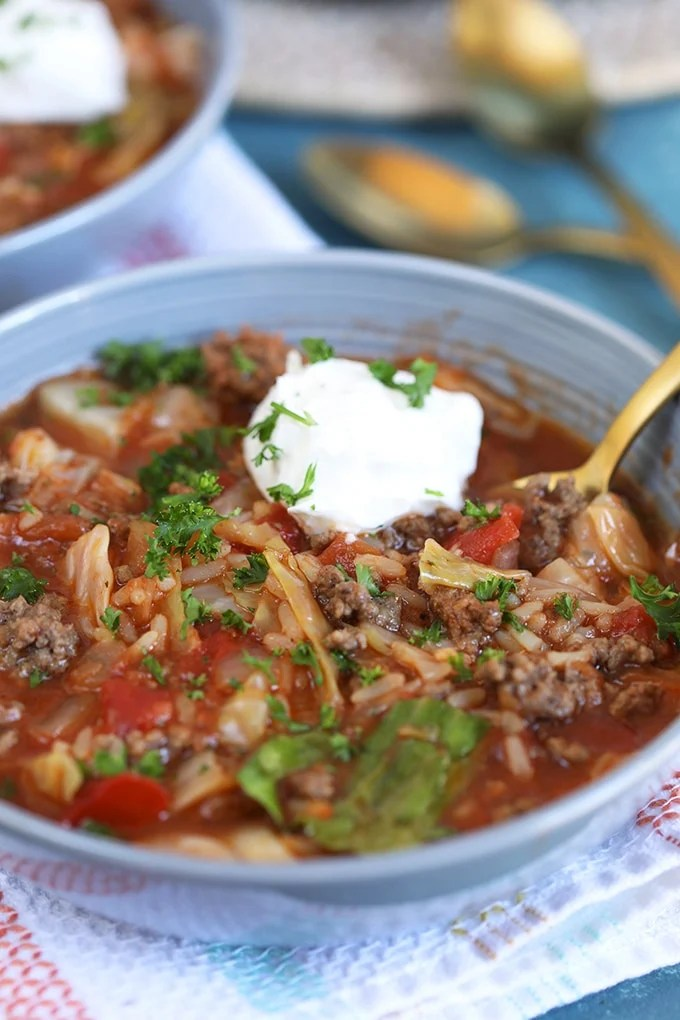 Close up shot of stuffed Cabbage Soup in a blue bowl.