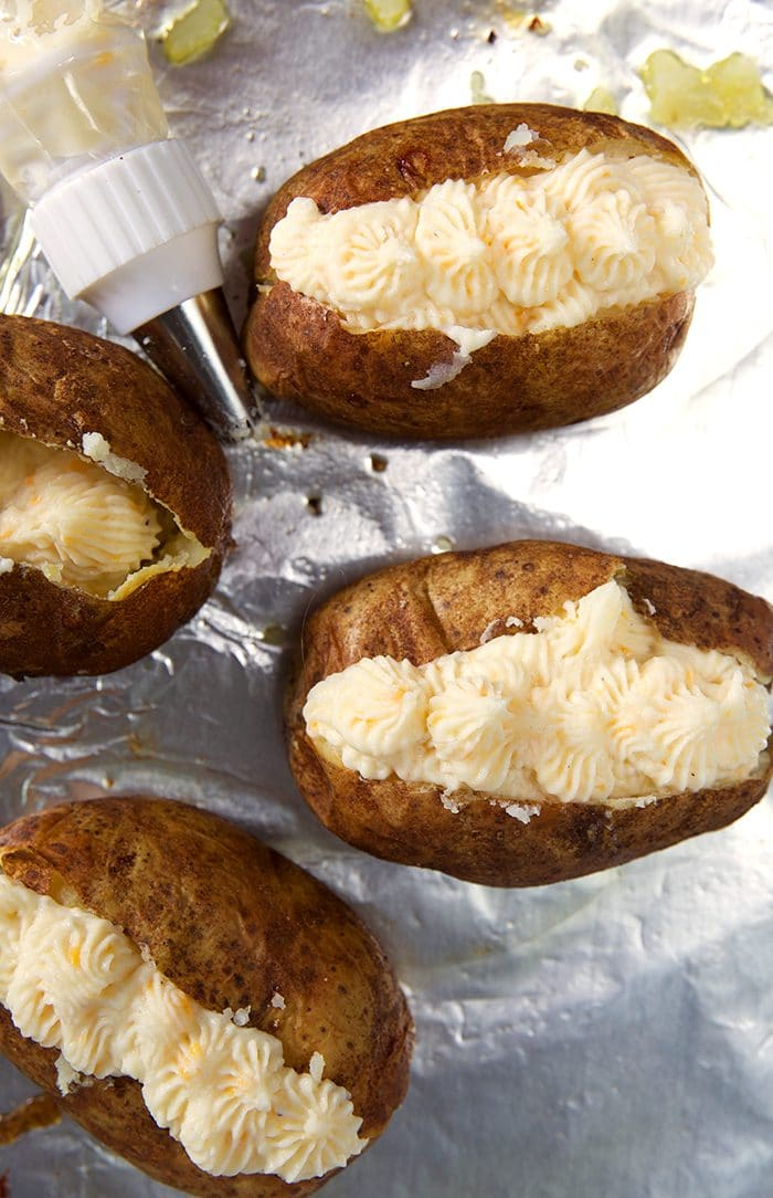Twice Baked Potatoes filled with potato filling before being baked for the second time.
