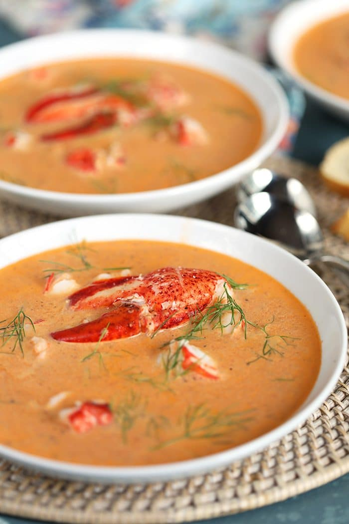 Two white bowls filled with Lobster Bisque.