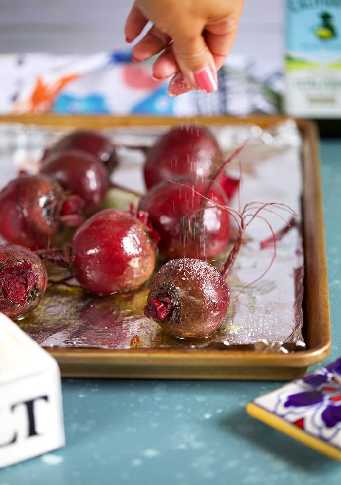 Beets on a baking sheet with olive oil and salt.