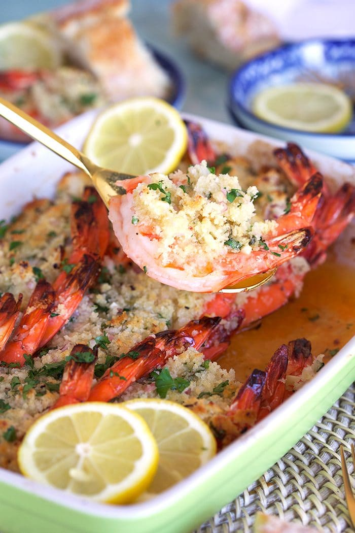 Baked Shrimp Scampi being served with a gold serving spoon.