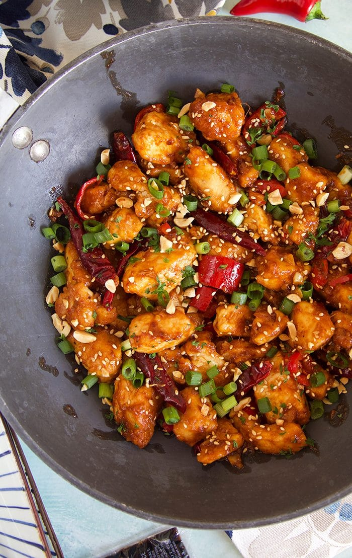 Overhead view of Szechuan Chicken in a black wok.
