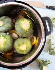 Overhead shot of artichokes in an Instant Pot.