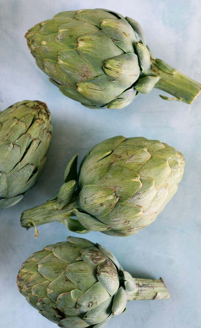 Artichokes on a blue background.
