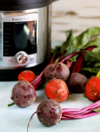 Instant Pot with fresh beets in front.