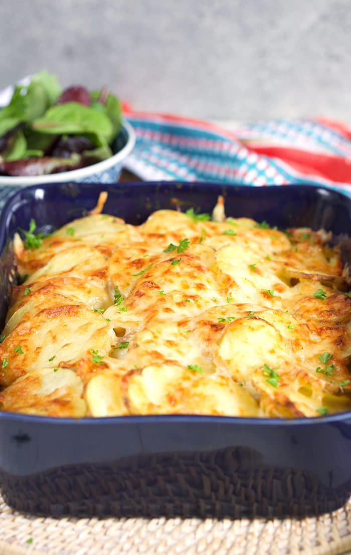 Scalloped Potatoes with ham in a blue casserole dish.