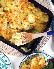 Overhead shot of scalloped potatoes and ham casserole in a baking dish.