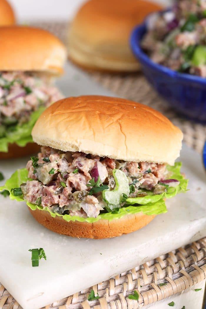 Close up of ham salad sandwich on a potato roll.