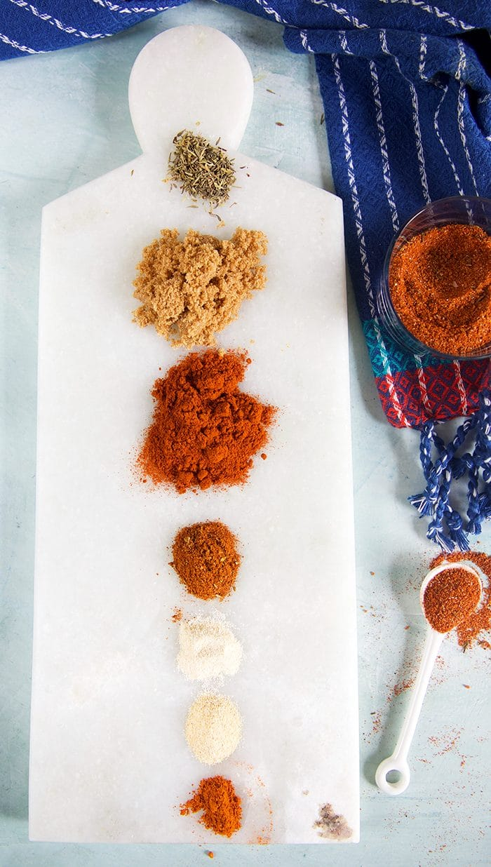 Piles of spices on a marble board.