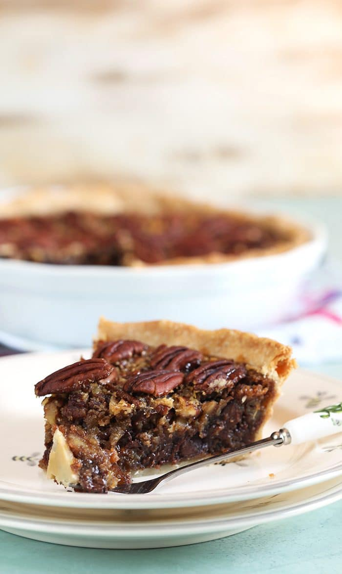 Close up of pecan pie with a bite taken off with a fork.