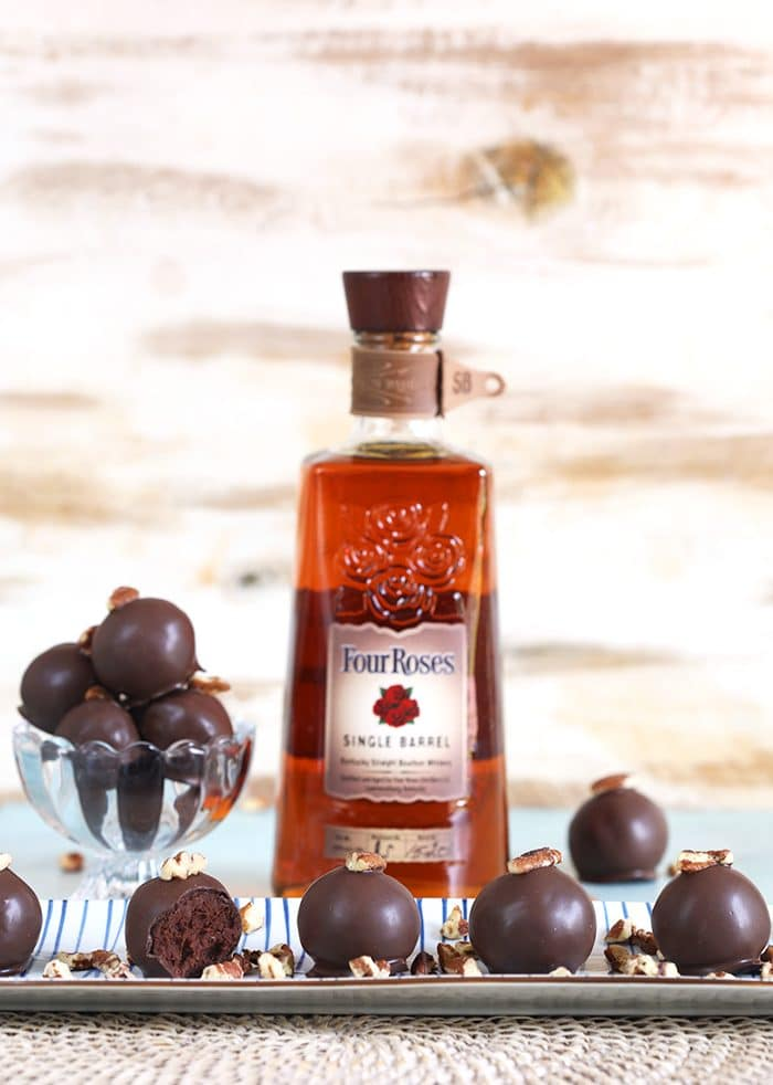 Bourbon Dark Chocolate Truffles with a bottle of bourbon.