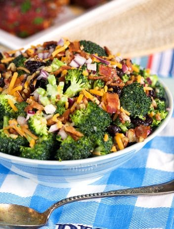 Broccoli Salad in a blue and white bowl.