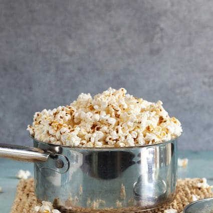 Popcorn in a stainless steel pot.