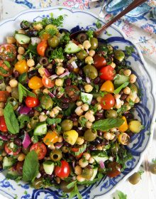 overhead shot of mediterranean chickpea salad in a blue and white bowl.