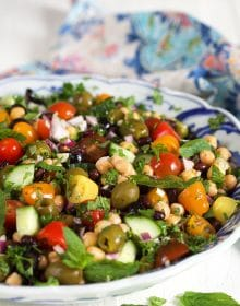 Close up of Mediterranean Chickpea Salad in a blue and white bowl.