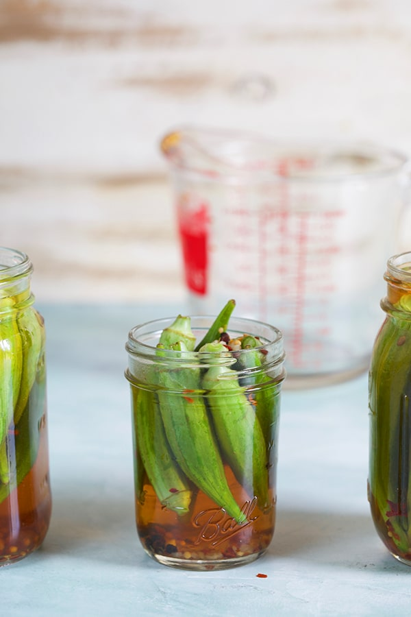 Okra in a canning jar filled with pickle brine.