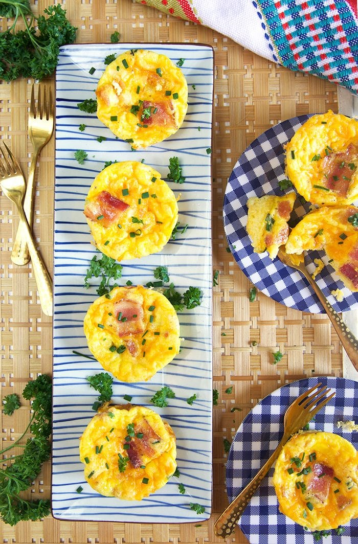 Overhead shot of egg muffin cups on a rectangle platter.