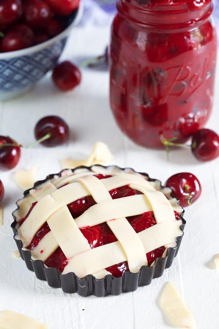 Cherry Pie tart with lattice crust on a white background.