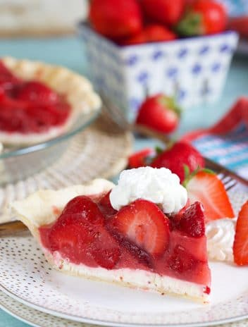 Slice of strawberry pie with cream cheese on a white plate.
