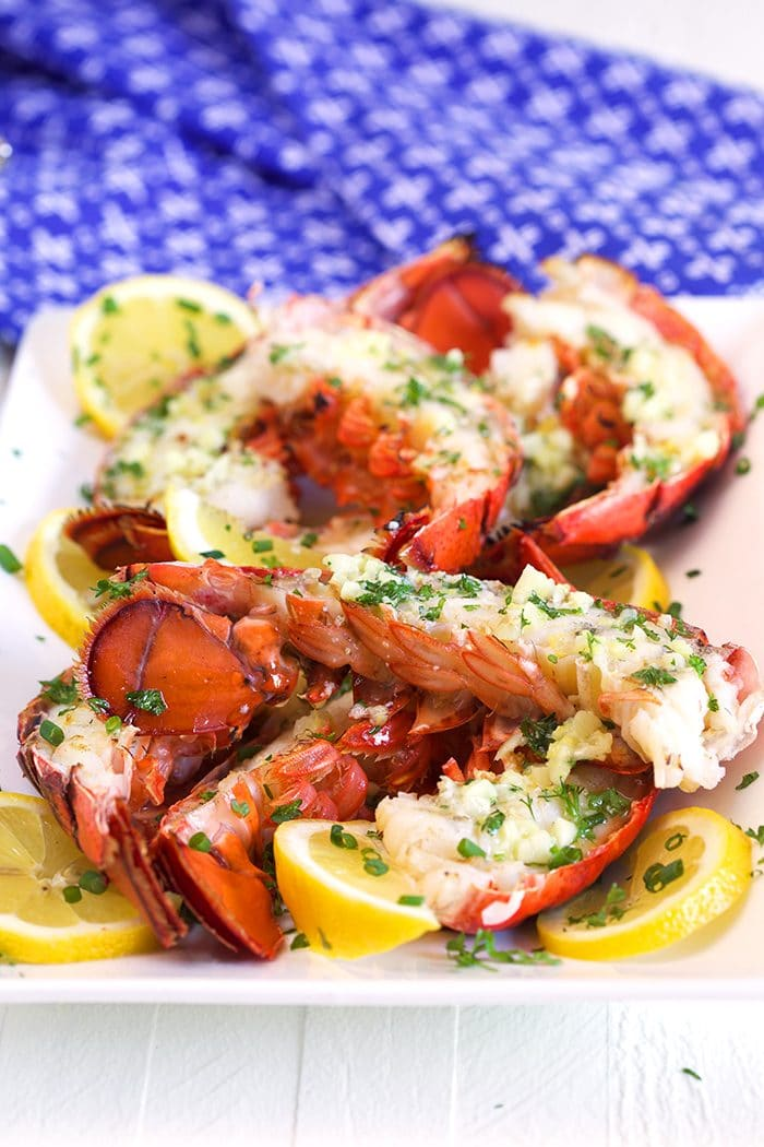 Grilled Lobster Tails on a white platter.