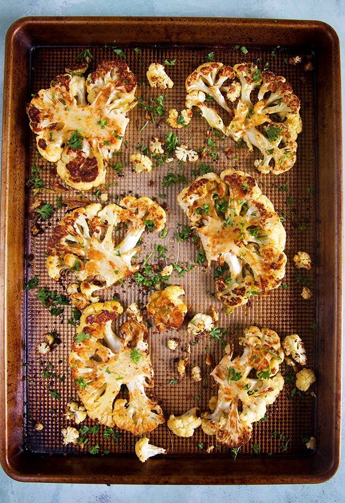 Baked Cauliflower Steaks on a sheet pan.