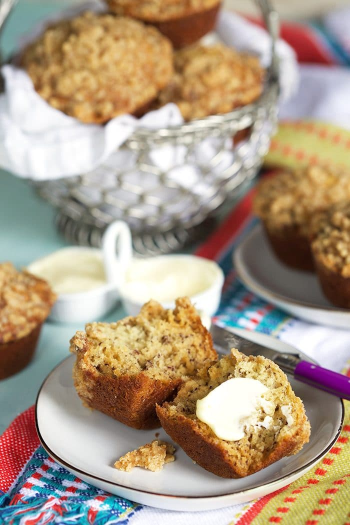 Banana Bread Muffins on a plate with a pat of butter.