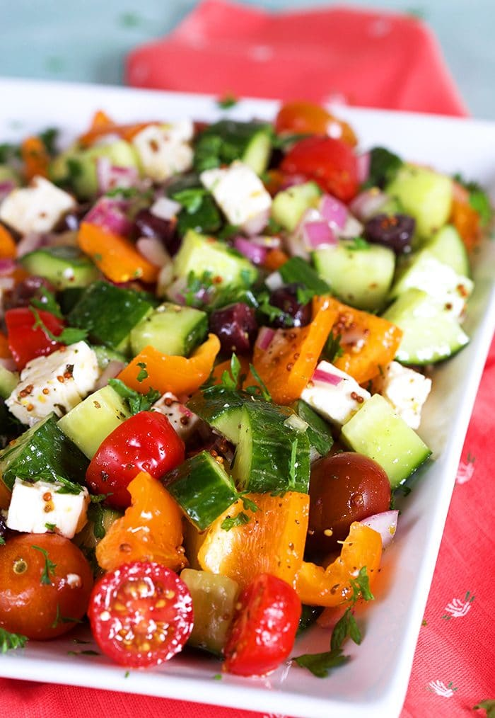 Close up of Greek Salad on a white platter.
