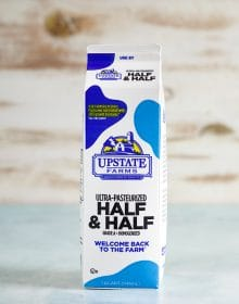 Carton of Half and Half on a blue background.