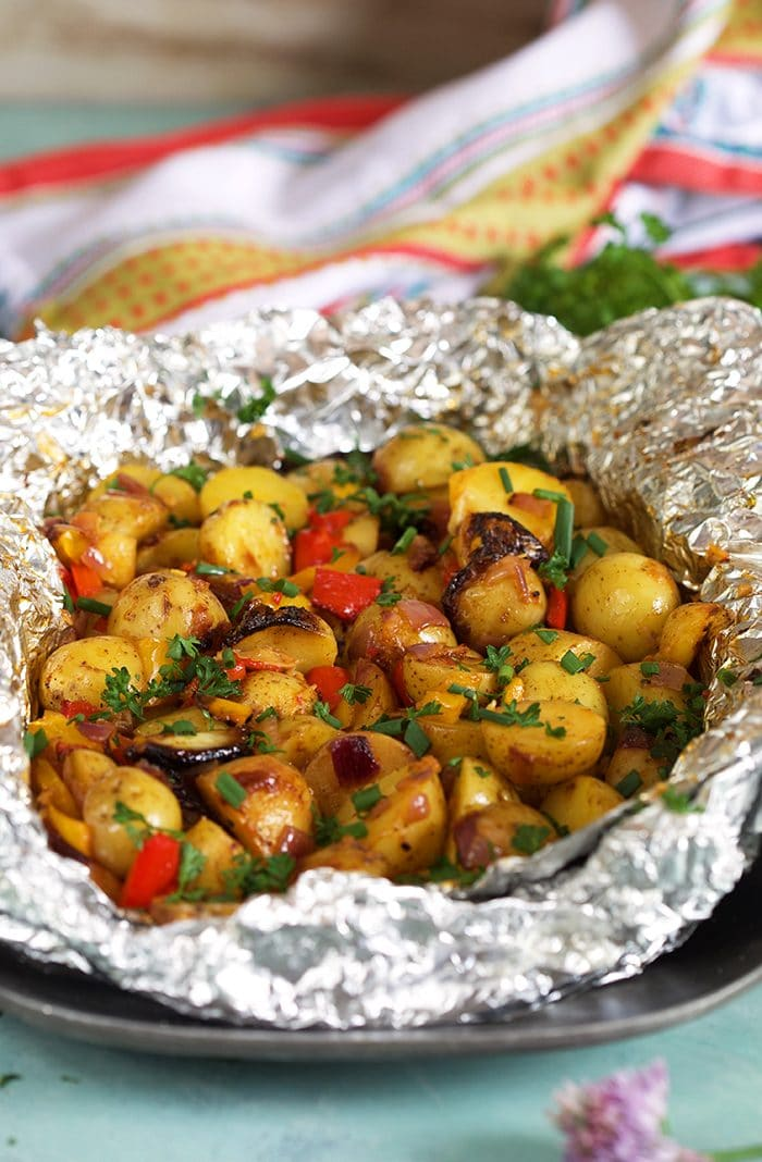 grilled potatoes in foil with pepper, onions and garlic.