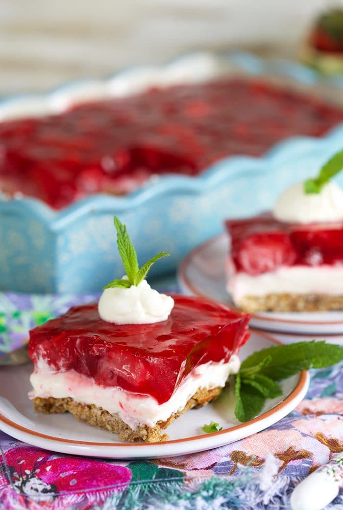 Strawberry Pretzel Salad on a white plate.