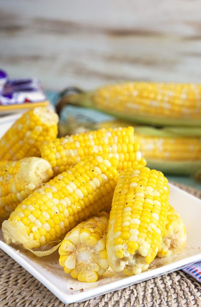Corn on the cob on a white platter.