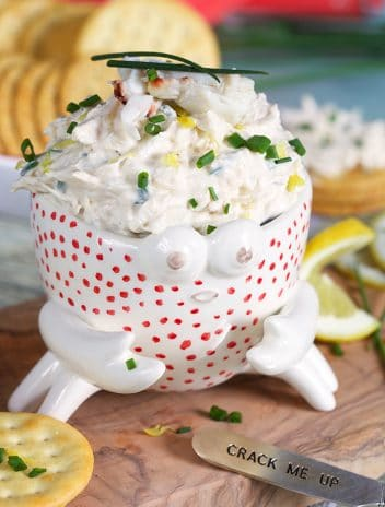 Crab dip in a crab bowl with crackers.