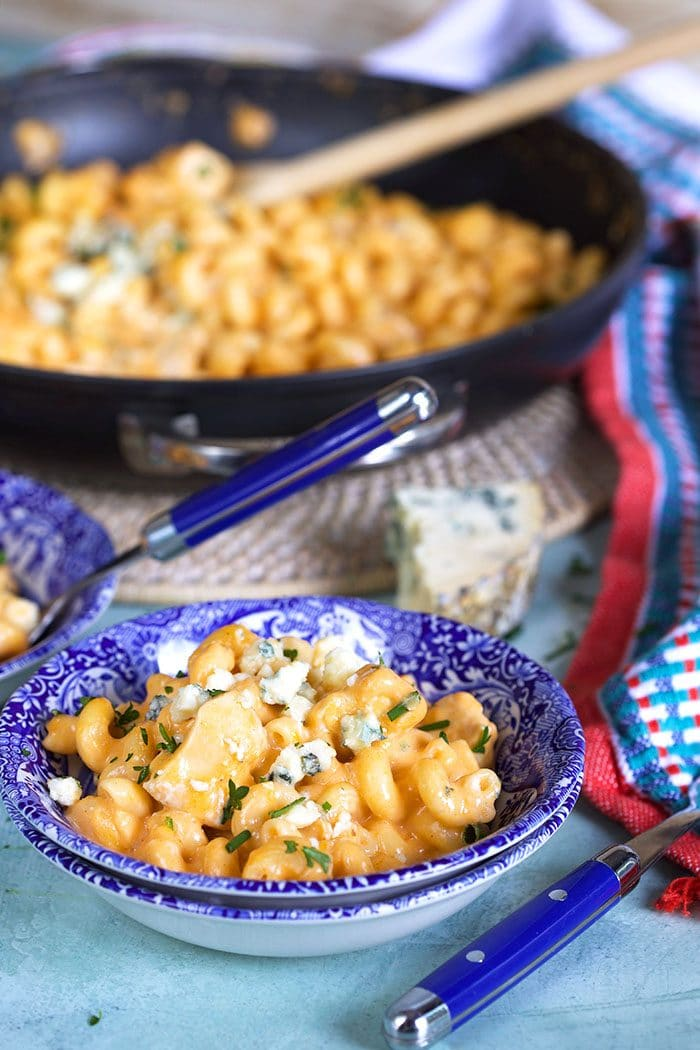 Buffalo Chicken pasta in a small blue and white bowl.