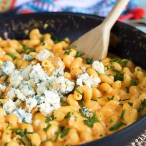 Buffalo Chicken Pasta with crumbled blue cheese on top.