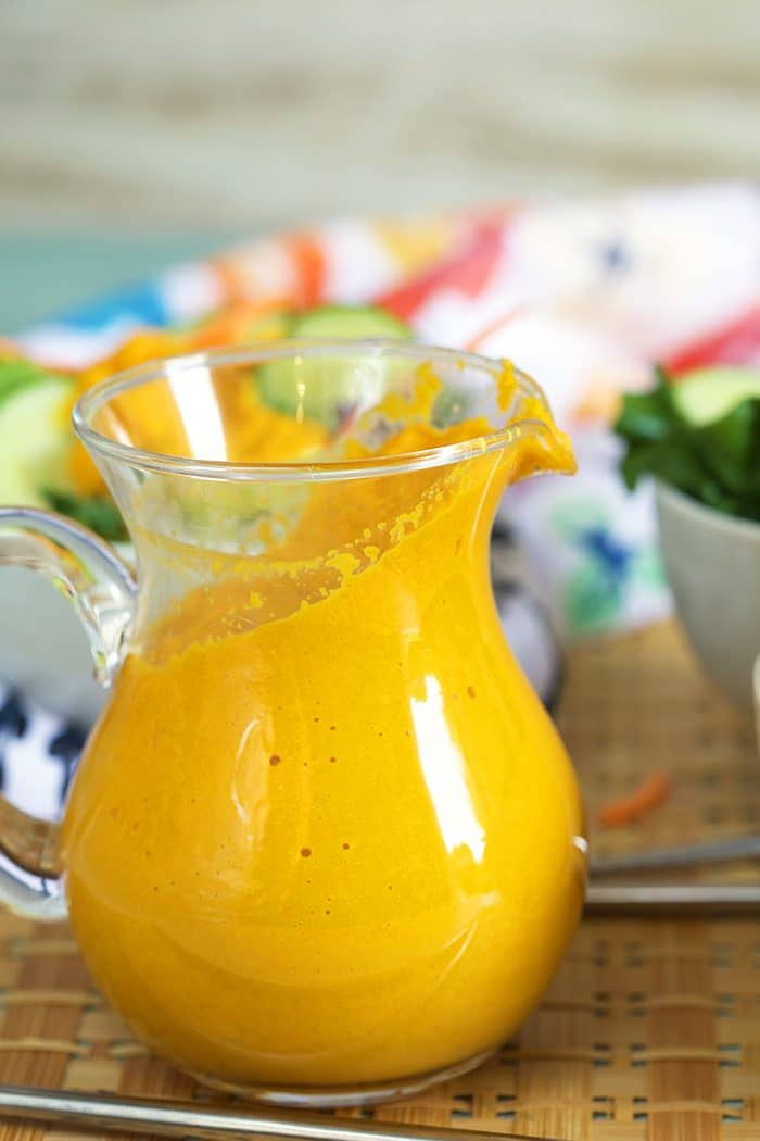 Ginger Dressing in a glass pitcher.