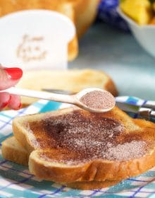 spoonful of cinnamon sugar sprinkled on a piece of cinnamon toast