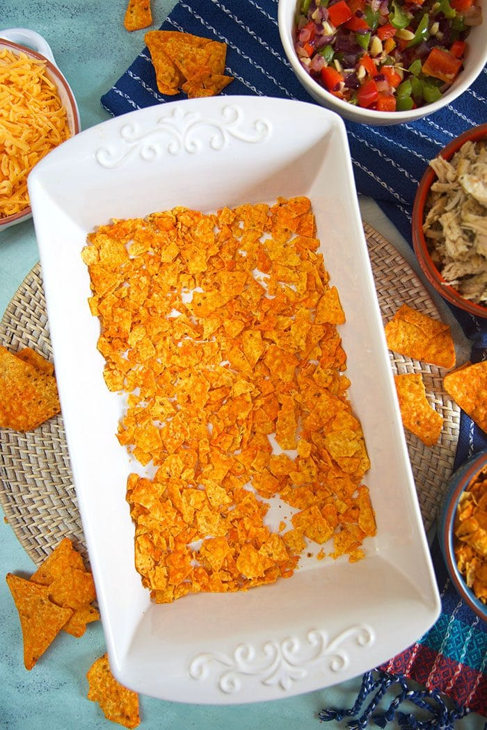 Crushed Doritos in a baking dish.